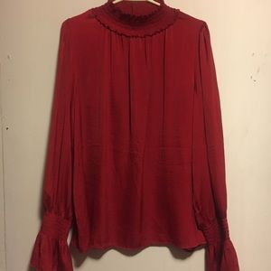 Used formal blouse with ruffles sleeves.